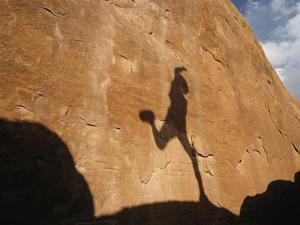 A Runners Shadow Falls on a Rock