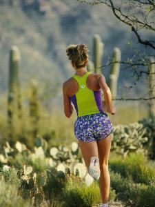 A Woman Runs Through the Desert Landscape by Dugald Bremner