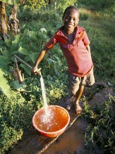 Boy at Water Tap, Chuka Village, Mount Kenya, Kenya, East Africa, Africa by Duncan Maxwell