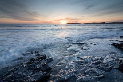 Dunstanburgh Castle at Sunrise, Seen from Embleton Bay, Northumberland, England, United Kingdom-Bill Ward-Photographic Print