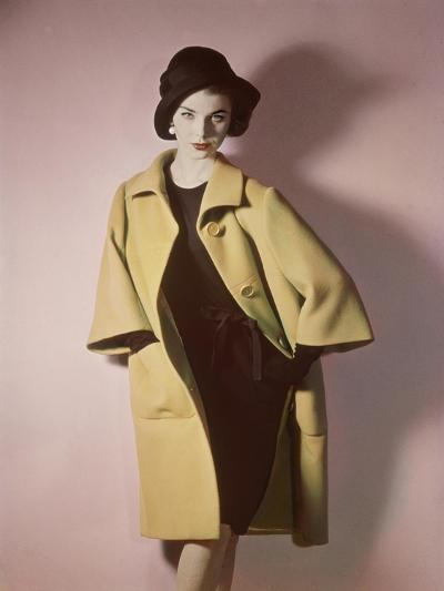 Duplicate of Model Wearing Bright Yellow Coat over Black Dress with Black Hat--Premium Photographic Print