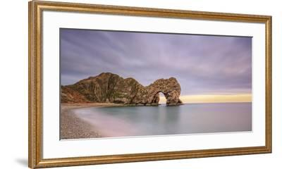 Dusk descends at Durdle Door on the Jurassic Coast, UNESCO World Heritage Site, Dorset, England, Un-Andrew Sproule-Framed Premium Photographic Print