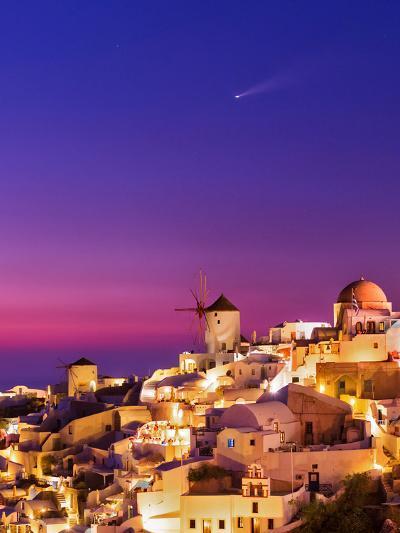 Dusk over the Aegean Sea and a Cliff-Top Town on Santorini Island. a Meteor Whizzes Overhead-Babak Tafreshi-Photographic Print