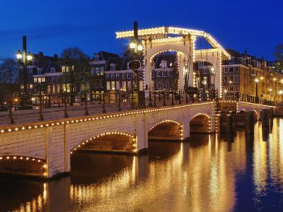 Dusk view of Magere Brug or Skinny Bridge and Amstel River, Netherlands, Holland-Adam Jones-Photographic Print