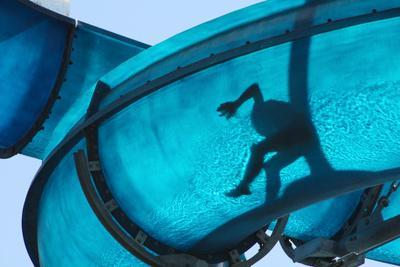 Kid Sliding a Blue Waterslide