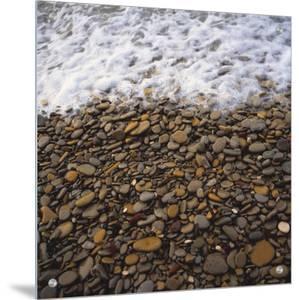 Rocks on a Beach by E.O.