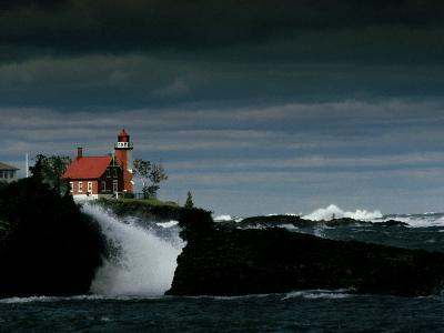 Eagle Harbor Lighthouse in Gale Force Winds--Photographic Print