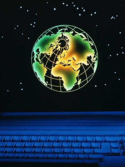 Earth Over Computer Keyboard-Tony Craddock-Photographic Print