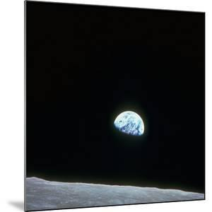 Earth Rising over Curvature of the Moon as Seen from Apollo 8