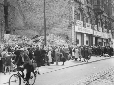 East Berliners Queueing in Front of a Currency Exchange Point in Invalidenstrasse, Berlin-Mitte,…-German photographer-Photographic Print