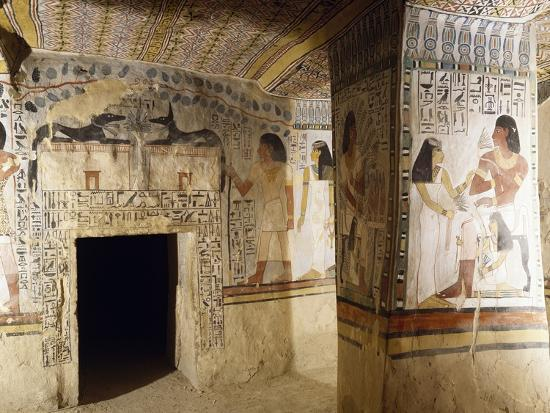 east wall of burial chamber with entrance decorated with figures of