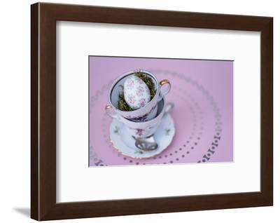 Easter decoration, coffee cups, stacked, Easter egg, bird's-eye view-mauritius images-Framed Photographic Print
