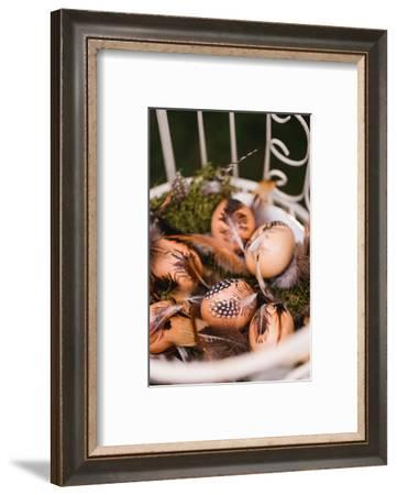 Easter nest with hen's feathers, Still life Easter-mauritius images-Framed Photographic Print