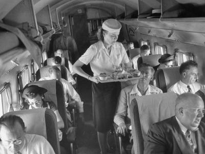 Eastern Airline Travelers Receiving a Mid-Flight Meal from a Female Steward--Photographic Print