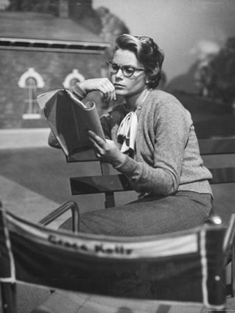 "Actress Grace Kelly Studying Script for Her Role of Georgie in ""The Country Girl"" on movie set"