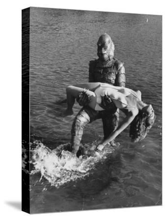 Actress Julia Adams is Carried by Monster, Gill Man, in the Movie, Creature from the Black Lagoon