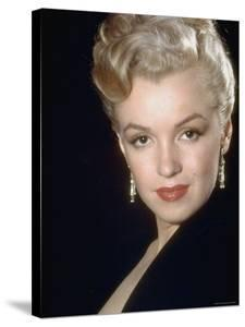 Actress Marilyn Monroe Wearing Dangling Rhinestone Earrings, with Her Hair Up by Ed Clark