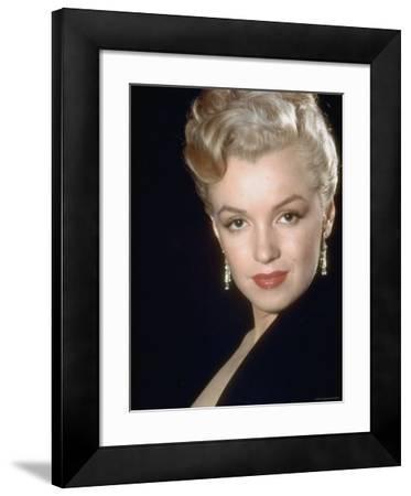 Actress Marilyn Monroe Wearing Dangling Rhinestone Earrings, with Her Hair Up