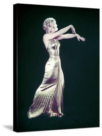 """Actress Marilyn Monroe Wearing Gold Gown Designed by Bill Travilla for """"Gentlemen Prefer Blondes"""""""