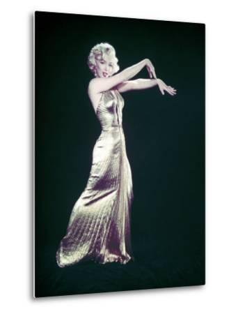 "Actress Marilyn Monroe Wearing Gold Gown Designed by Bill Travilla for ""Gentlemen Prefer Blondes"""