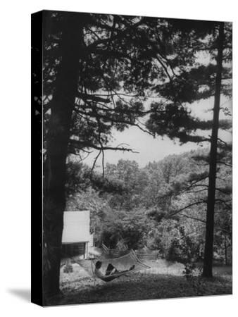 Billy Graham Reading the Bible Outside the Cabin Where He Seeks Seclusion