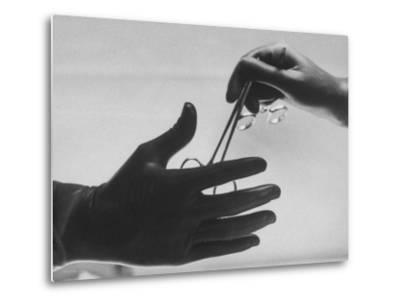 During Training of Surgeon, Often Used Clamp Is Slapped into His Hand