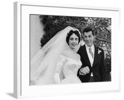 Elizabeth Taylor Wearing Beautiful Satin Wedding Gown with Husband Nicky Hilton Outside Church