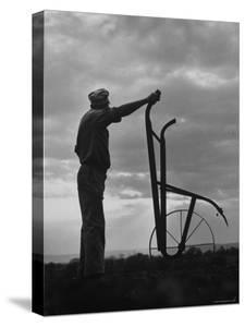 Farmer Plowing the Fields by Ed Clark