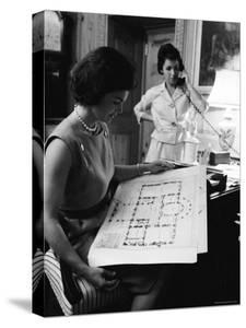 First Lady Jacqueline Kennedy Looking over Blueprints While Continuing to Redecorate White House by Ed Clark