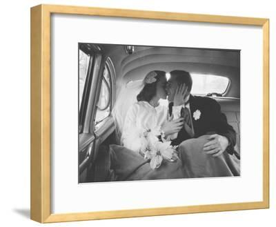 Mr. and Mrs. Thomas Beagan Jr. Kissing in Back of Car after their Wedding Ceremony