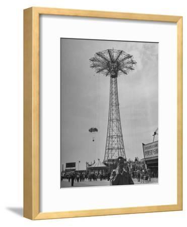 People Enjoying a Ride at Coney Island Amusement Park
