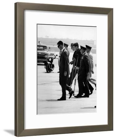 Pres. John F. Kennedy on Crutches Due to Back Ailment