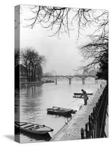 Rowboats Tied Up Along the Seine River by Ed Clark