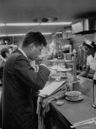 Senator John F. Kennedy Drinking a Cup of Coffee at a Cafe in Washington Airport