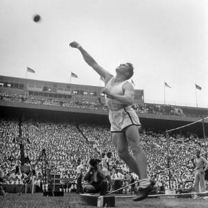Shot Putter Francis Delaney in Mid-Throw in an Attempt to Qualify During the U.S. Olympic Tryouts by Ed Clark