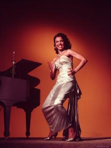 Singer and Actress Dorothy Dandridge Posing by a Piano by Ed Clark