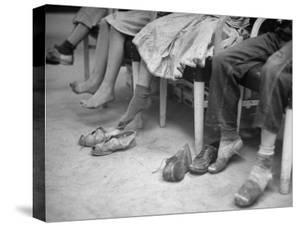 Stamping their Feet, Children from the Avondale Camp Wait to Be Fitted with Free Shoes by Ed Clark