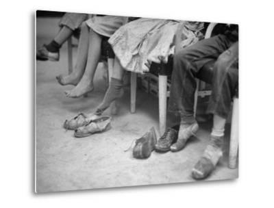 Stamping their Feet, Children from the Avondale Camp Wait to Be Fitted with Free Shoes