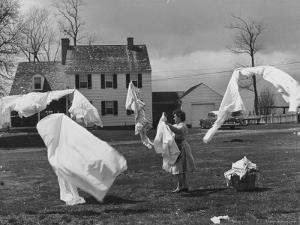 Woman Hanging Up the Laundry on the Line by Ed Clark