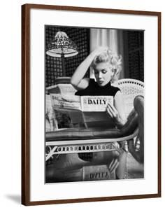 Marilyn Monroe Reading Motion Picture Daily, New York, c.1955 by Ed Feingersh