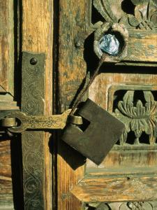 A Doorway with an Ornately Carved Latch and Window by Ed George