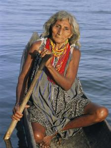 A Warao Indian in a Canoe by Ed George