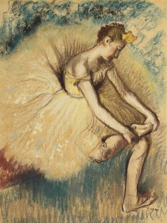 A Dancer Putting on her Shoe by Edgar Degas