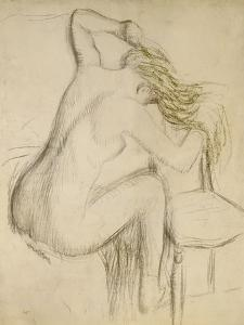 A Seated Woman Styling Her Hair by Edgar Degas