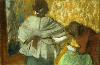 At the Couturiere, the Fitting by Edgar Degas