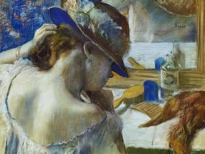 In Front of the Mirror, about 1889 by Edgar Degas