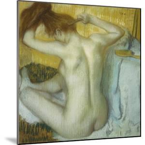 Woman at Her Toilette, 1885 by Edgar Degas