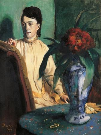 Woman Seated beside a Vase of Flowers by Edgar Degas