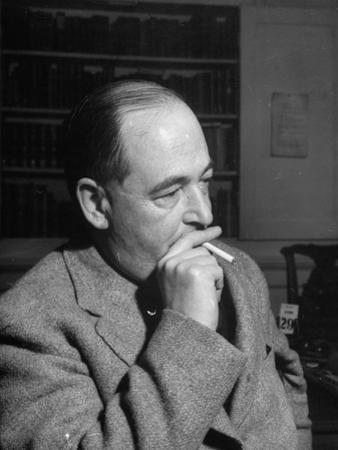 Educator C. S. Lewis Dragging on Cigarette During Interview