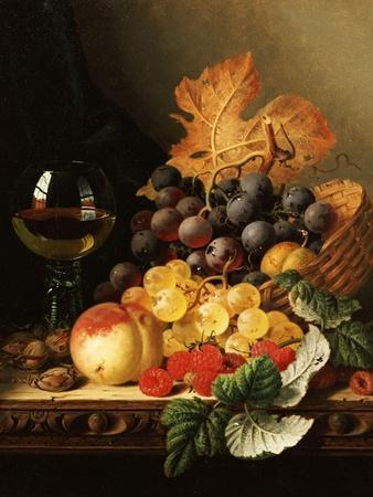 A Basket of Grapes, Raspberries, a Peach and a Wine Glass on a Table